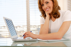 woman-writing-on-computer-at-home